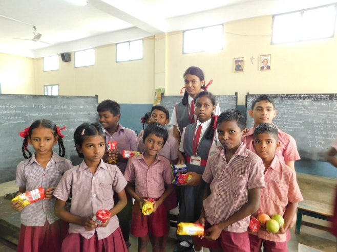 Joy multiplies when it is shared among the less fortunate. The children of St. Joseph's joyfully shared goodies during the season of Christmas with the students of Dominic Savio Primary School, Perambur.