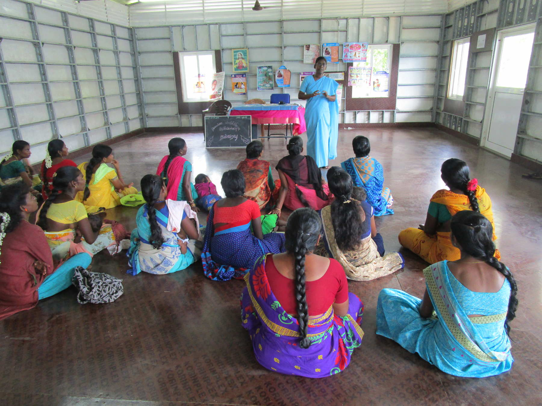 Sr. Arul Kala Royappan giving awareness on health to Self Help Group women.