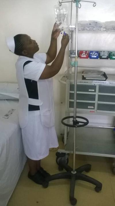 Sr Clementina Simataa preparing a drip