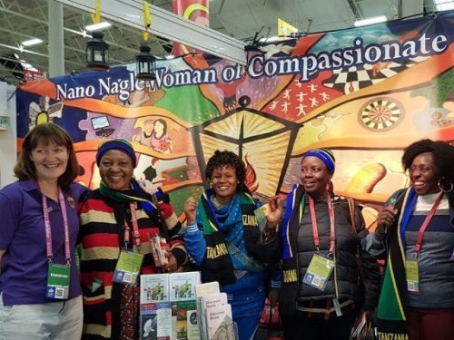 Sr. Bernadette Purcell (left) welcoming some friends from Tanzania at the Presentation Sister's stand at the World Meeting of Families (WMOF2018) in Dublin, with Sr. Eileen Clear).