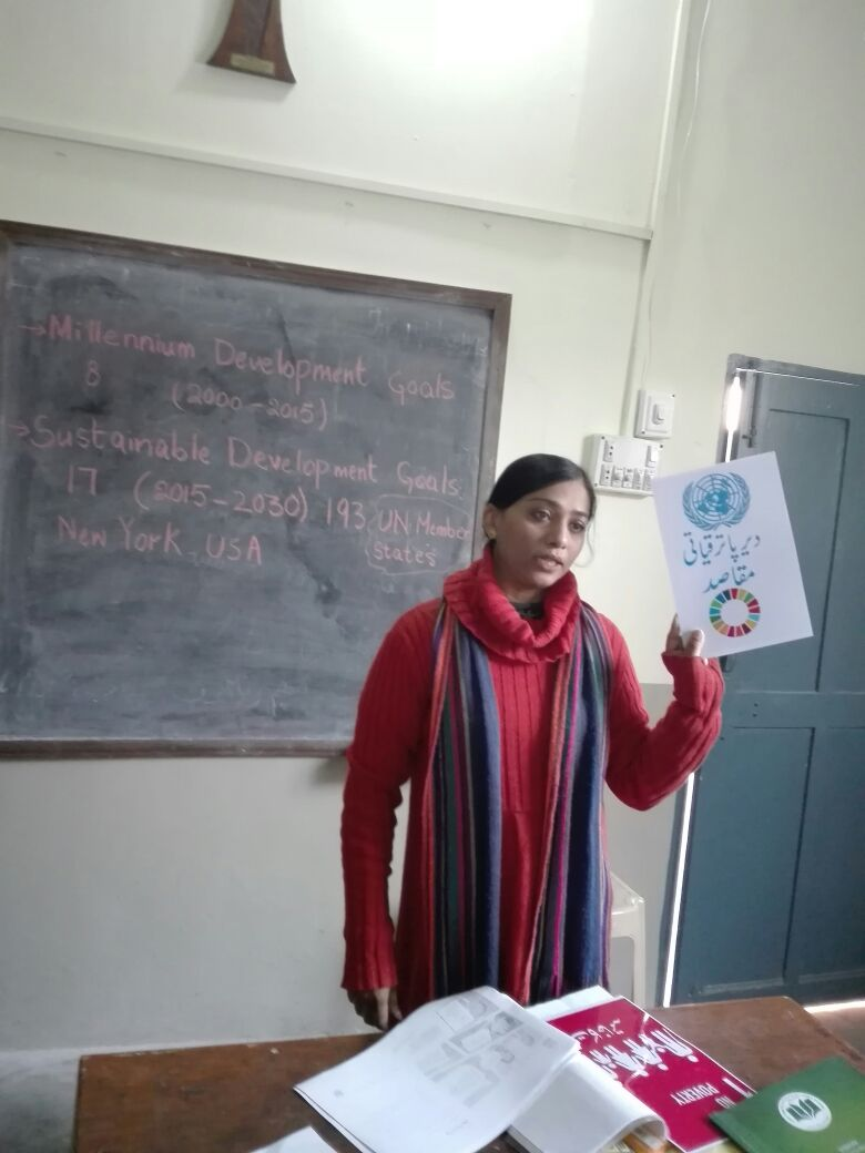 Community leader teaching SDGs