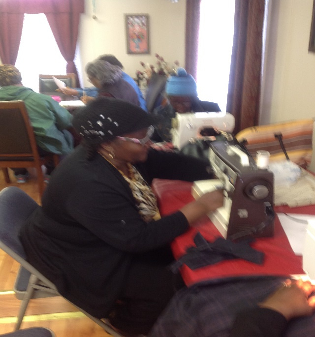 Ladies are sewing reversal bags which they filled with different items for the home