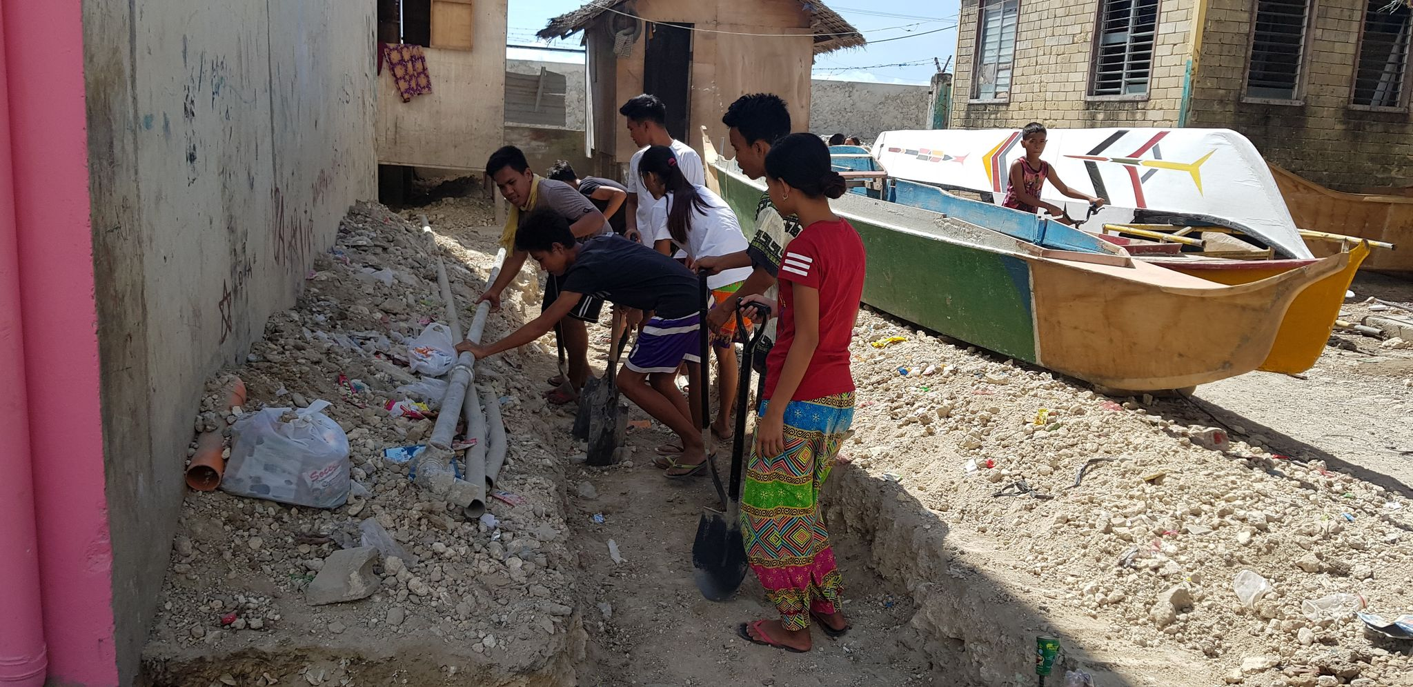 Badjao Youth during a community clean-up