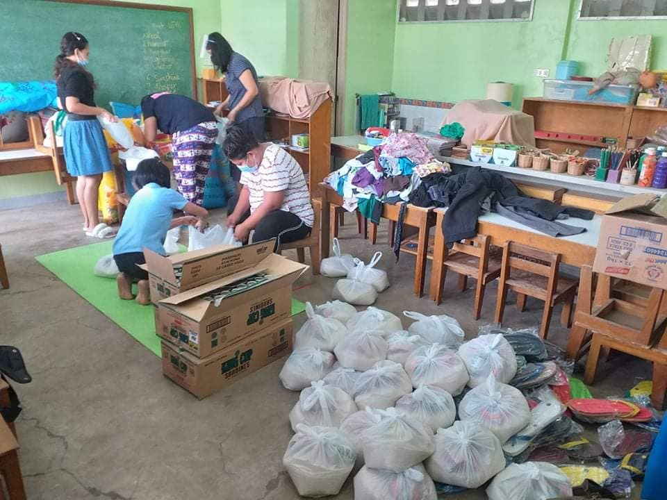 Srs VicVic and July with the teachers preparing goods for distribution to the Badjao families