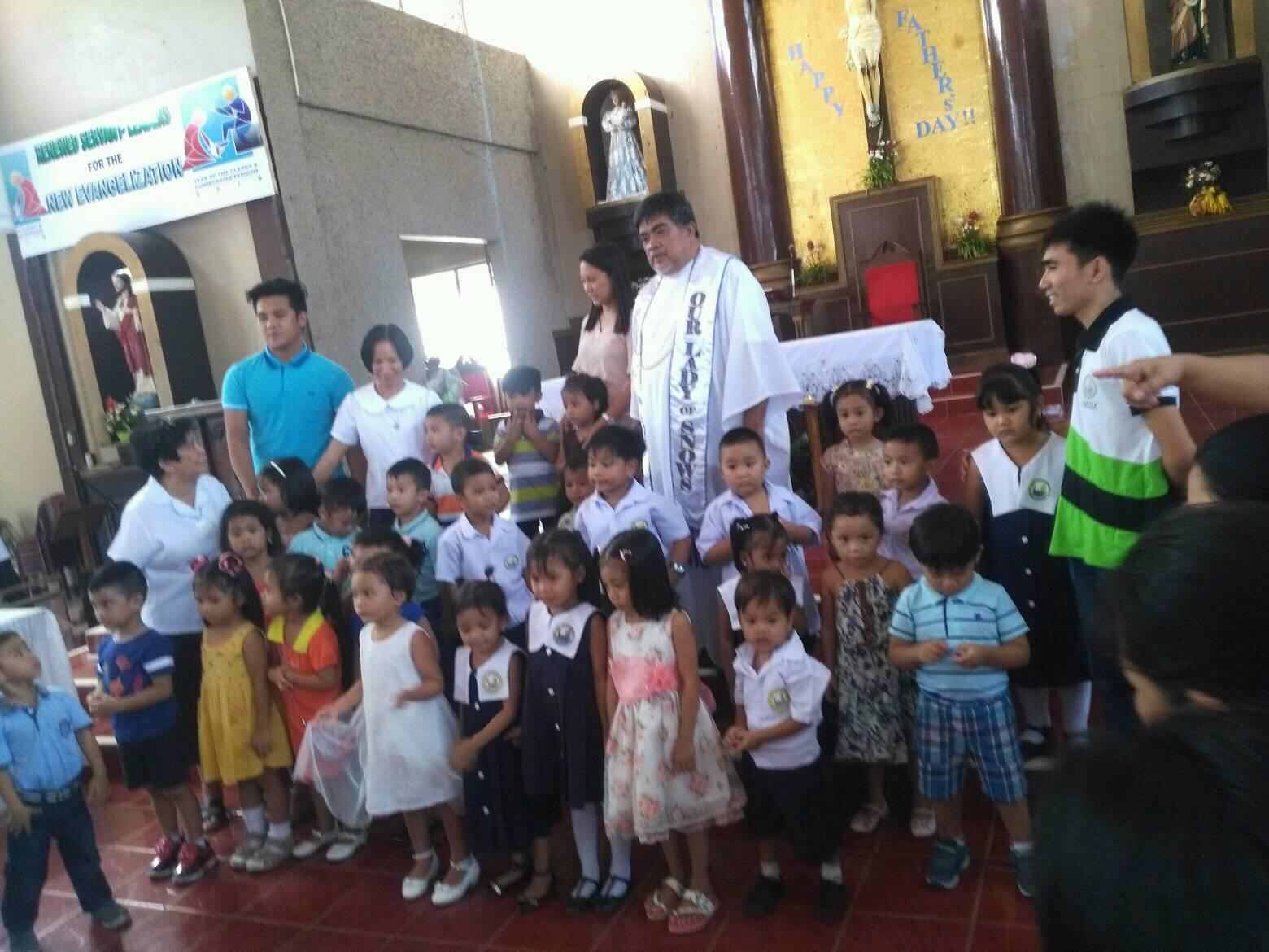 Kinder pupils after their Thanksgiving Mass with Srs Teresita and July and their teachers
