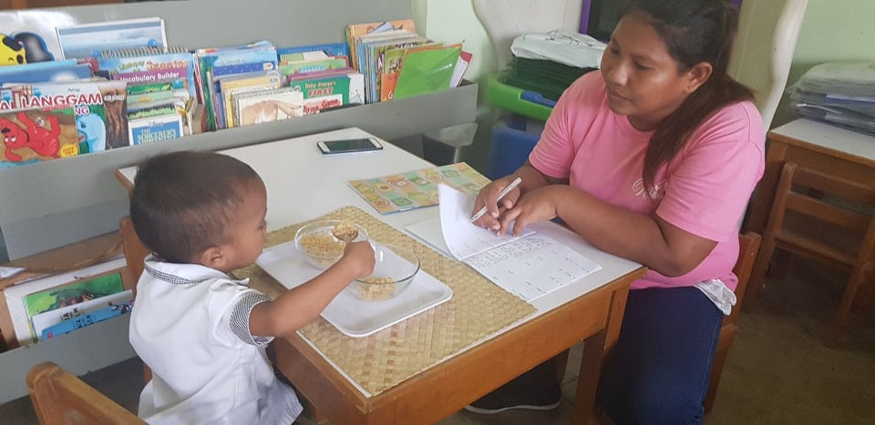 Montessori instruction- Teacher Pau with a Badjao Pupil