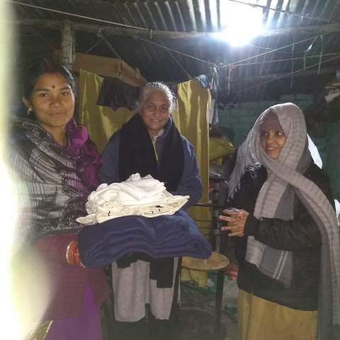Distribution of warm cloths to poor